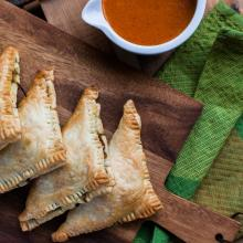 Veggie hand pies with red pepper sauce